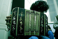 Flavio Regiani, 26, plays the bandoneon (a small accordion, a  German bellows instruments that produce the quintessential sound of the tango) during a music class in which students were asked to put a new music to and all tango song, at the National Academy of Tango in Buenos Aires, May 16, 2003. Photo by Quique Kierszenbaum
