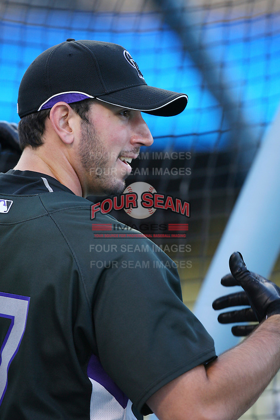 Joe Koshansky of the Colorado Rockies during batting practice before a game against the Los Angeles Dodgers in a 2007 MLB season game at Dodger Stadium in Los Angeles, California. (Larry Goren/Four Seam Images)