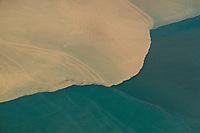 aerial photograph of muddy river sediment flowing into the Pacific Ocean, Panama | fotografía aérea de sedimento fluvial fangoso que fluye hacia el Océano Pacífico, Panamá