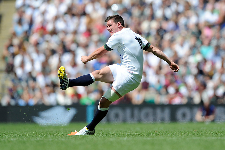 Freddie Burns of England takes a kick during the match between England and Barbarians at Twickenham on Sunday 26th May 2013 (Photo by Rob Munro)