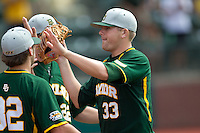 Baylor Bears pitcher Tyler Bremer #33 is greeted by his team during the NCAA Regional baseball game against Oral Roberts University on June 3, 2012 at Baylor Ball Park in Waco, Texas. Baylor defeated Oral Roberts 5-2. (Andrew Woolley/Four Seam Images)
