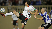 4 June 2005: Santino Quaranta of DC United kicks the ball away from Wade Barrett of Earthquakes during the second half of the game at Spartan Stadium in San Jose, California.  Earthquakes tied DC United at 0-0.   Credit: Michael Pimentel