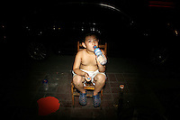CHINA. Beijing. A young boy drinking. 2008