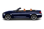 Car driver side profile view of a 2018 BMW M4 Base 2 Door Convertible