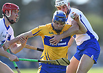 Podge Collins of Clare  in action against Tadhg de Burca and Shane Fives of Waterford during their National League game at Cusack Park. Photograph by John Kelly.