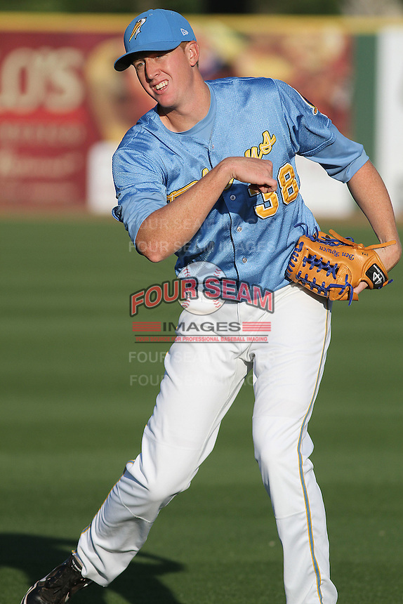 Myrtle Beach Pelicans pitcher Ben Rowan #38 warming up in the outfield before a game against the Frederick Keys at Tickerreturn.com Field at Pelicans Ballpark on April 24, 2012 in Myrtle Beach, South Carolina. Frederick defeated Myrtle Beach by the score of 8-3. (Robert Gurganus/Four Seam Images)