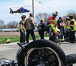 CareFlight lifts off from the scene of a motorcycle vs. car crash at the intersection of US36 and Mulberry Grover-Rakestraw Road on Sunday morning.
