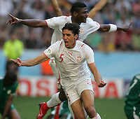 Tunisian forward (5) Zied Jaziri celebrates his goal with teammate (15) Radhi Jaidi close behind. Saudi Arabia and Tunisia played to a 2-2 tie in their FIFA World Cup Group H match at FIFA World Cup Stadium, Munich, Germany, June 14, 2006.