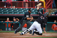 Erie SeaWolves catcher John Hicks (41) raises his glove to show the ball as umpire Erich Bacchus calls out Drew Dosch (not pictured) at home during a game against the Bowie Baysox on May 12, 2016 at Jerry Uht Park in Erie, Pennsylvania.  Bowie defeated Erie 6-5.  (Mike Janes/Four Seam Images)