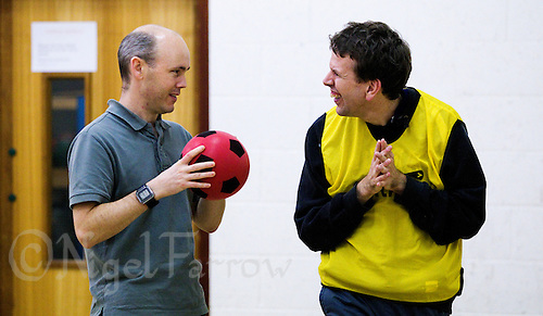 20 OCT 2011 - DISS, GBR - Iain Dawson talks with one of the members of the multi sport club for people with learning disabilities that he helped to found after becoming aware of its need during his work as a physiotherapist (PHOTO (C) NIGEL FARROW)