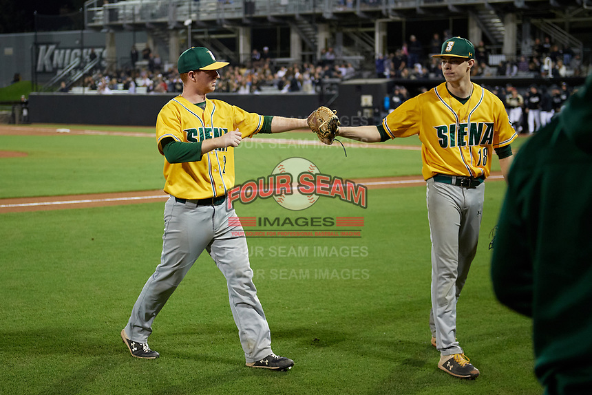 Siena Saints shortstop Zach Durfee (2) and pitcher Mike McCully (18) during a game against the UCF Knights on February 14, 2020 at John Euliano Park in Orlando, Florida.  UCF defeated Siena 2-1.  (Mike Janes/Four Seam Images)