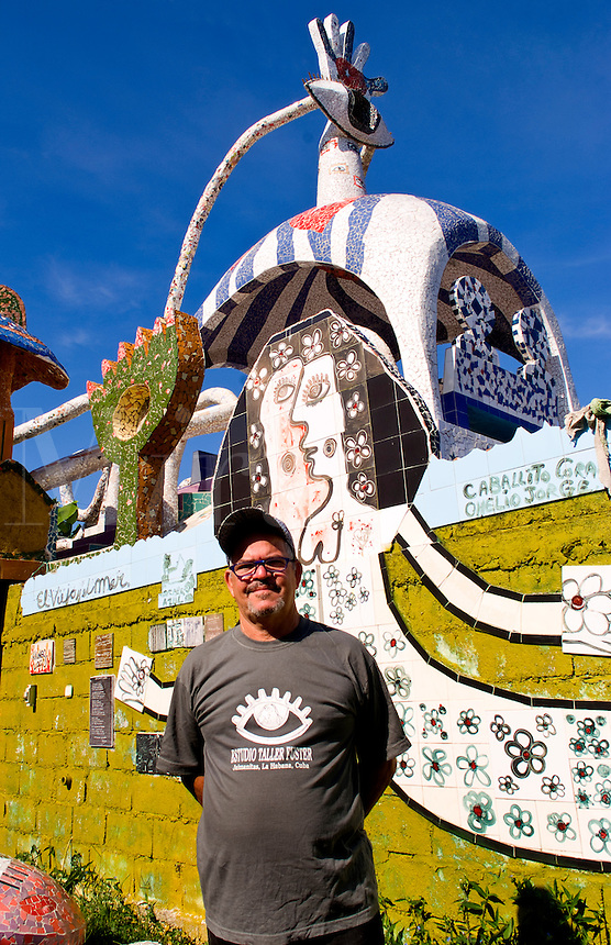 Portrait of the artist Jose Fuster in Havana Cuba at his home with ceramics and  with his wild color tiles in Jaimanitas section of Habana