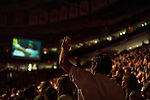 """Sunday, June 24, Raleigh, North Carolina..California evangelist Greg Laurie, brought his """"Harvest Crusade"""" to the RBC Center in Raleigh, NC for 3 days of music. prayer and Christian evangelism. Laurie brought together 200 local churches to sponsor the event which used 3000 volunteers and hopes to convert many newcomers to his version of born again Christianity.. Believers danced and prayed to the hour and a half long music program that preceded Laurie's sermon."""