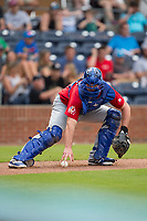 Buffalo Bisons catcher Mike Ohlman (14) reaches for the baseball after a wild pitch during the game against the Durham Bulls at Durham Bulls Athletic Park on April 30, 2017 in Durham, North Carolina.  The Bisons defeated the Bulls 6-1.  (Brian Westerholt/Four Seam Images)