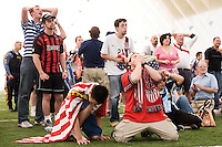 USA fans react to a missed opportunity by USA's Landon Donovan (not pictured). The Red Bulls hosted a FIFA World Cup viewing party for the USA v Italy match at the Giants Stadium practice bubble, East Rutherford, NJ, June 17, 2006.