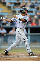 Kannapolis Intimidators second baseman Micah Johnson #37 swings at a pitch during a game against the Asheville Tourists at McCormick Field on May 9, 2013 in Asheville, North Carolina. The Intimidators won the game 13-12. (Tony Farlow/Four Seam Images).