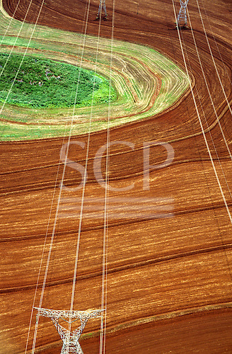 Parana State, Brazil. High voltage pylons and electricity lines on agricultural land from Itaipu hydroelectric dam.