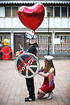 © Joel Goodman - 07973 332324 . 26/08/2017. Manchester , UK. A man and a woman wearing costumes in homage to Banksy stencils at the 2017 Pride parade through Manchester City Centre . The annual festival , which is the largest of its type in Europe , celebrates LGBT life . Photo credit : Joel Goodman