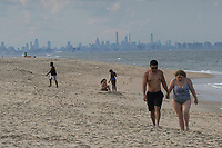 SANDY HOOK, NJ - JUNE 26: People visit the beach of Sandy Hook front of the skyline of lower Manhattan on June 26, 2020 in Sandy Hook, New Jersey. The State continue it's reopening while the U.S. hit record for new coronavirus cases. (Photo by Kena Betancur/ VIEWpress via Getty Images)