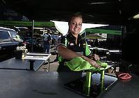 Feb. 16, 2013; Pomona, CA, USA; NHRA crew member for funny car driver Alexis DeJoria during qualifying for the Winternationals at Auto Club Raceway at Pomona.. Mandatory Credit: Mark J. Rebilas-