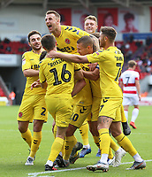Fleetwood Town's Conor McAleny is mobbed after scoring the opening goal <br /> <br /> Photographer David Shipman/CameraSport<br /> <br /> The EFL Sky Bet League One - Doncaster Rovers v Fleetwood Town - Saturday 17th August 2019  - Keepmoat Stadium - Doncaster<br /> <br /> World Copyright © 2019 CameraSport. All rights reserved. 43 Linden Ave. Countesthorpe. Leicester. England. LE8 5PG - Tel: +44 (0) 116 277 4147 - admin@camerasport.com - www.camerasport.com