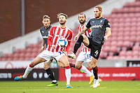 31st October 2020; Bet365 Stadium, Stoke, Staffordshire, England; English Football League Championship Football, Stoke City versus Rotherham United; Nick Powell of Stoke City is tackled by Shaun MacDonald of Rotherham United
