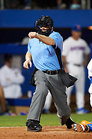 Home plate umpire Josh Miller strike three call during a game between the Siena Saints and Florida Gators on February 16, 2018 at Alfred A. McKethan Stadium in Gainesville, Florida.  Florida defeated Siena 7-1.  (Mike Janes/Four Seam Images)