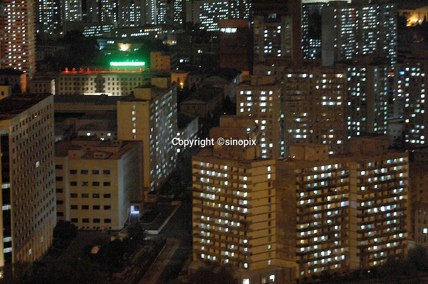 "Pyongyang city at night. The DPRK (Democratic People's Republic of Korea) is the last great dictatorship where the people are bombarded with images of the ""Eternal President"" Kim Il-sung who died in 1994 and his son and current leader Kim Jong-il who are worshipped like a God."