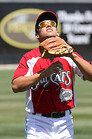 Jake Kahaulelio #3 of the Carolina Mudcats fielding a pop fly before a game against the Montgomery Biscuits on April 18, 2010 in Zebulon, NC.