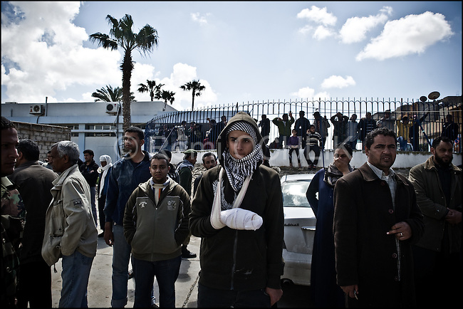 © Remi OCHLIK/IP3 -   Benghazi  March 20, 2011 - .In front of the morgue Libyan people wait for the body of a family member.- At least 84 people, most of them are civilians , and had been killed in the Ghadafi air strike the day before.