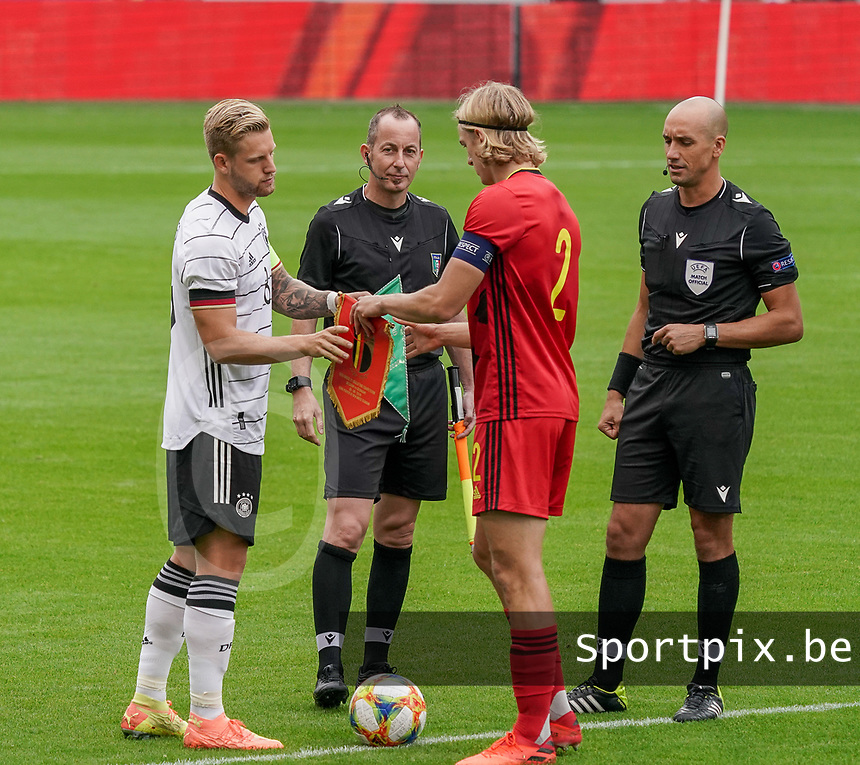 Germany's captain Arne Maier (L) exchanges flags with Belgium's captain Sebastiaan Bornauw (2) before a soccer game between the national teams Under21 Youth teams of Belgium and Germany on the 5th matday in group 9 for the qualification for the Under 21 EURO 2021 , on tuesday 8 th of September 2020  in Leuven , Belgium . PHOTO SPORTPIX.BE | SPP | SEVIL OKTEM