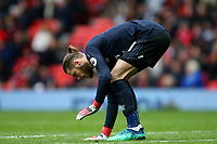 David De Gea of Manchester United touches the pitch during the Premier League match between Manchester United and Swansea City at the Old Trafford, Manchester, England, UK. Saturday 31 March 2018