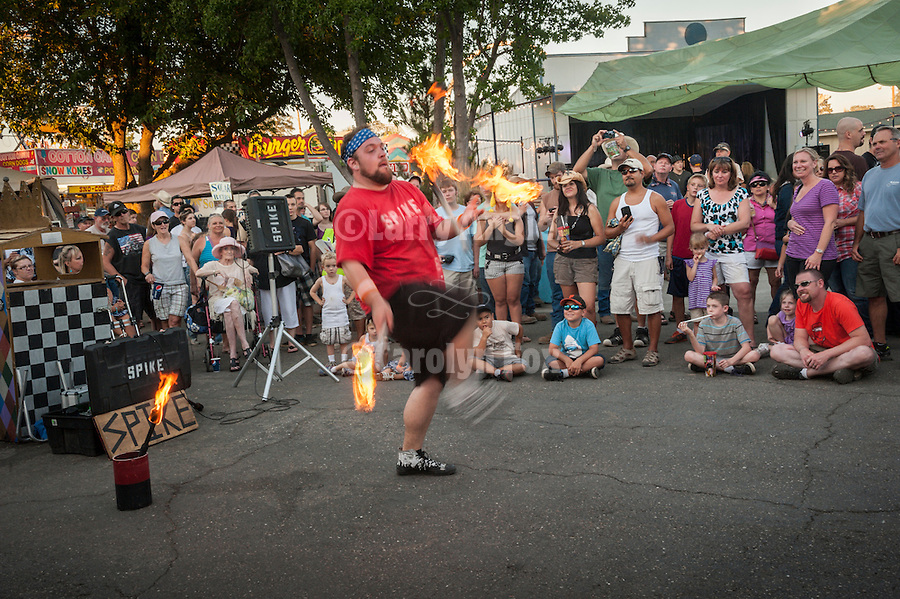 75th Amador County Fair, Plymouth, Calif.<br /> <br /> Spike the juggler and street performer entertains the crowds on Day 3 by juggling four fire battons