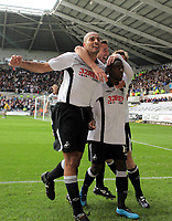 ATTENTION SPORTS PICTURE DESK<br /> Pictured: (L-R) Darren Pratley, Federico Bessone and Nathan Dyer of Swansea City in action <br /> Re: Coca Cola Championship, Swansea City Football Club v Cardiff City FC at the Liberty Stadium, Swansea, south Wales. Saturday 07 November 2009