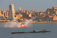 WEEHAWKEN, NJ - JULY 4: FDNY fire boat Marine 1 Forty Three puts on a water show on the Hudson river prior to the annual Macy's Fourth of July fireworks on Monday, July 4, 2011.