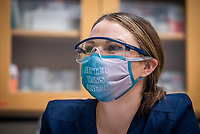 Brittney Horn reads off instructions to her lab partner as UAA Medical Assisting Program students learn to sterilize medical instruments during their first in-person lab of the Fall 2020 semester. While 80% of UAA's courses have shifted to online delivery this fall as a result of the COVID-19 pandemic, in-person labs are still being offered for some health-related, vocational, and science fields in which hands-on learning is considered critical.