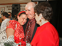 Arkansas Democrat-Gazette/BOB COLEMAN<br /> John McDonnell, University of Arkansas head cross country and track and field coach, hugs his daughter Heather (left) and hugs wife Ellen after  announcing his retirement from the university program Monday afternoon. 4/21/08