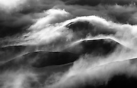 Early morning clouds roll over and around Pu'u O Maui and other cinder cones in Haleakala National Park, Maui. This image won 1st Place B&W - State Open at the 1999 Maui County Fair's photo contest.