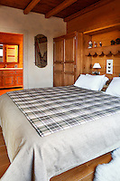 traditional wooden bedroom with bathroom