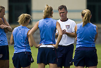 USA head coach Greg Ryan talks to his players during practice at Shenhua FC in Shanghai, China, on September 25, 2007.
