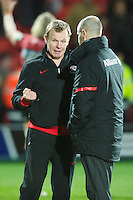 20121216 Copyright onEdition 2012©.Free for editorial use image, please credit: onEdition..Mark McCall, Saracens Director of Rugby, celebrates with substitute Charlie Hodgson of Saracens during the Heineken Cup Round 4 match between Saracens and Munster Rugby at Vicarage Road on Sunday 16th December 2012 (Photo by Rob Munro)...For press contacts contact: Sam Feasey at brandRapport on M: +44 (0)7717 757114 E: SFeasey@brand-rapport.com..If you require a higher resolution image or you have any other onEdition photographic enquiries, please contact onEdition on 0845 900 2 900 or email info@onEdition.com.This image is copyright onEdition 2012©..This image has been supplied by onEdition and must be credited onEdition. The author is asserting his full Moral rights in relation to the publication of this image. Rights for onward transmission of any image or file is not granted or implied. Changing or deleting Copyright information is illegal as specified in the Copyright, Design and Patents Act 1988. If you are in any way unsure of your right to publish this image please contact onEdition on 0845 900 2 900 or email info@onEdition.com