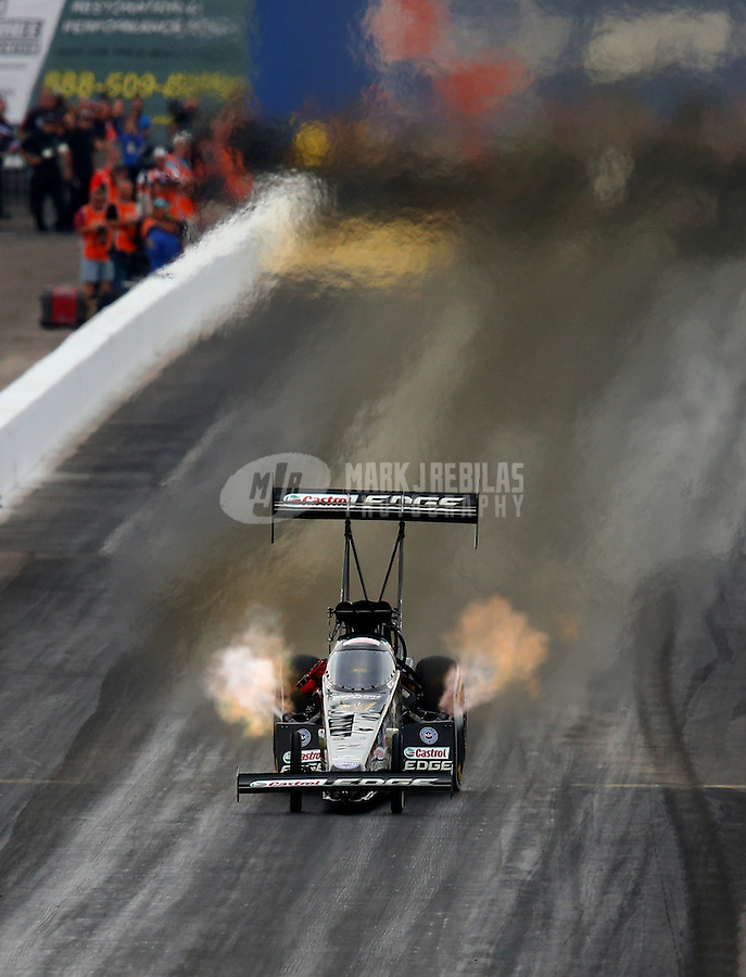 Feb 22, 2014; Chandler, AZ, USA; NHRA top fuel dragster driver Brittany Force during qualifying for the Carquest Auto Parts Nationals at Wild Horse Motorsports Park. Mandatory Credit: Mark J. Rebilas-USA TODAY Sports