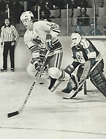 1976 FILE PHOTO - ARCHIVES -<br /> <br /> Toronto Toro's Paul Henderson leaps out of way of puck in front of Phoenix Roadrunners' goalie Gary Kurt, but Kurt blocked shot anyway as Phoenix went on to defeat Toros, 5-2. Henderson did wreck Kurt's shutout bid late in game with carom shot off goalie's stick. Actually score flattered Toros who trailed 5-0 before scoring 1st goal. Defenceman Jim Turkiewicz got other goal for sagging Toros.<br /> <br /> <br /> Bezant, Graham<br /> Picture, 1976,<br /> <br /> 1976<br /> <br /> PHOTO : Graham Bezant - Toronto Star Archives - AQP