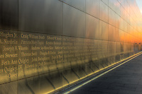 Twilight colors in the western sky provide a colorful background and reflections on the New Jersey 9/11 Empty Sky Memorial.  The memorial, which honors the New Jersey residents lost in the events of September 11, 2001, is located in Liberty State Park in Jersey City, New Jersey.