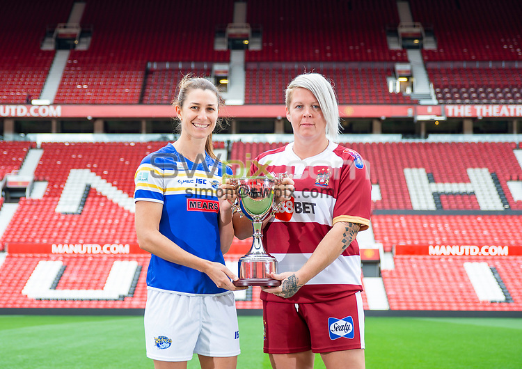 Picture by Allan McKenzie/SWpix.com - 08/10/2018 - Rugby League - Betfred Super League Grand Final Preview - Old Trafford, Manchester, England - Leeds' Courtney Hill & Wigan's Gemma Walsh with the Womans Rugby Football League Super League Trophy.