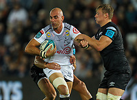 8th October 2021;  Swansea.com Stadium, Swansea, Wales; United Rugby Championship, Ospreys versus Sharks; Ruan Pienaar of Cell C Sharks is tackled by Rhys Webb and Jac Morgan of Ospreys