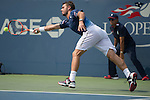 Stanislas Wawrinka (SUI) finally defeats Hyeon Chung (KOR)  7-6, 7-6, 7-6 at the US Open in Flushing, NY on September 3, 2015.