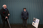 Greenock Morton 2 Stranraer 0, 21/02/2015. Cappielow Park, Greenock. Two elderly home supporters pictured inside an entrance to the stadium before Greenock Morton take on Stranraer in a Scottish League One match at Cappielow Park, Greenock. The match was between the top two teams in Scotland's third tier, with Morton winning by two goals to nil. The attendance was 1,921, above average for Morton's games during the 2014-15 season so far. Photo by Colin McPherson.