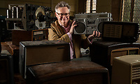 BNPS.co.uk (01202) 558833. <br /> Pic: CorinMesser/BNPS<br /> <br /> Pictured: Richard Bromell of Charterhouse Auctioneers with the collection. <br /> <br /> Radio Ga-Ga..<br /> <br /> A vast collection of vintage radios, televisions and record players have emerged for sale at auction following the death of their owner.<br /> <br /> The group, which consists of hundreds of old-school electronics, was amassed over several decades by an eccentric and dedicated collector.<br /> <br /> An electrician by trade, he housed the goods in a private museum near Dorchester in Dorset but rarely displayed them to the general public.