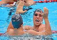 July 30, 2012..Matt Grevers and Nick Thoman celebrate after capturing  Gold and Silver Medal in Men's 100m Backstroke Final at the Aquatics Center on day three of 2012 Olympic Games in London, United Kingdom.